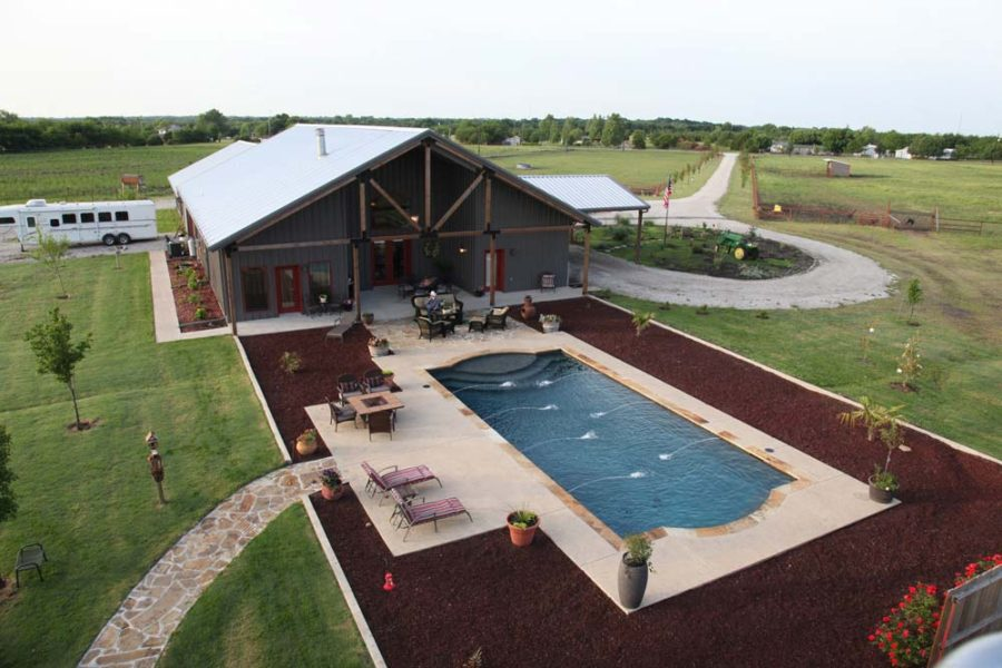 A complete metal building home with a pool and a stable for Metal building for home