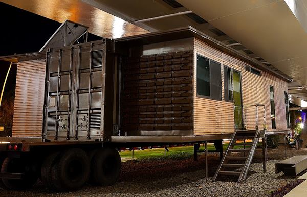 Expanding Shipping Container Home That Transports On A Flatbed